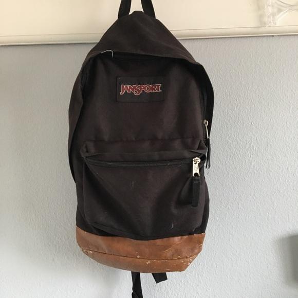 Black Jansport Backpack With Leather Bottom